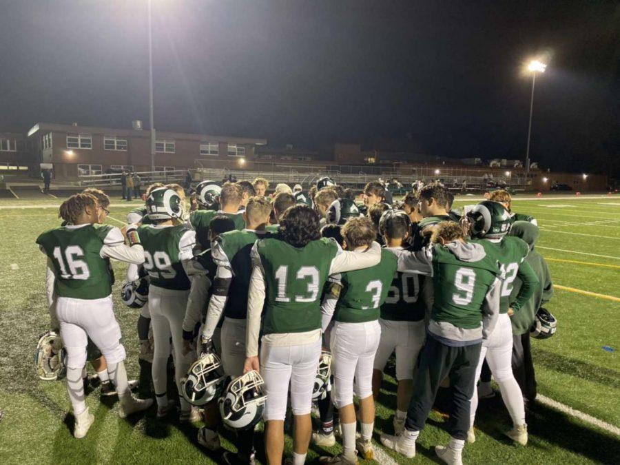 Football+team+huddles+after+a+big+game