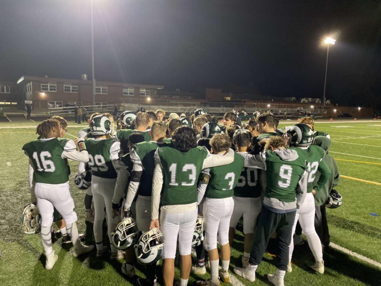 Football team huddles after a big game
