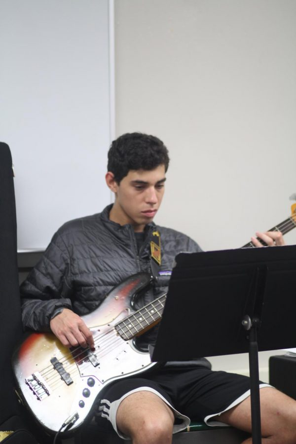 Senior Kevin Urban plays bass while practicing the 'Godspell' score.