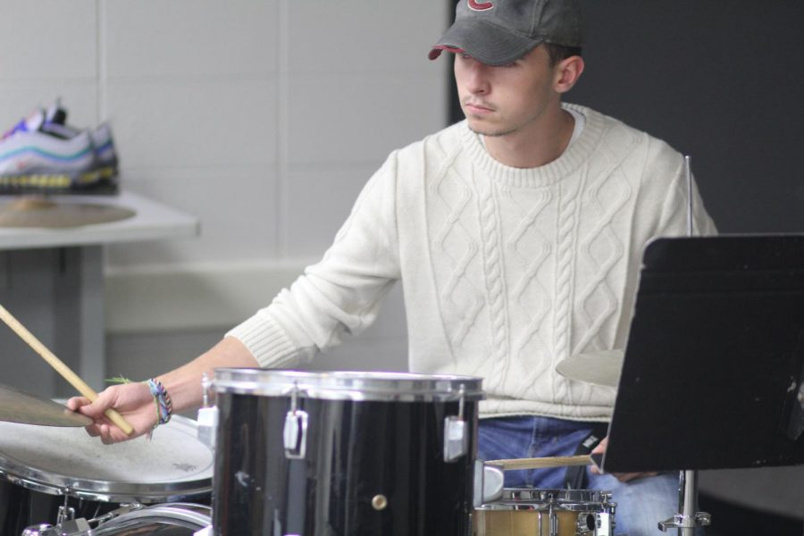 Senior Nick Bean plays drums in the 'Godspell' band.