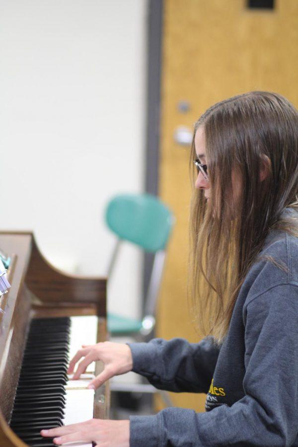 Senior Corinne Heidloff plays piano for the 'Godspell' band.  Photo by Daniel Laubhan