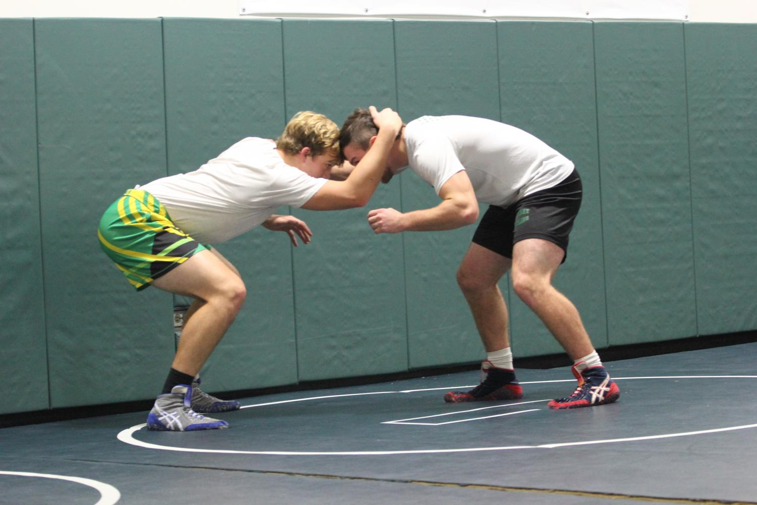 Juniors Jake Lester and Joey Jens enhance their skills during open mat.