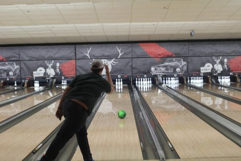 Boys bowling strikes