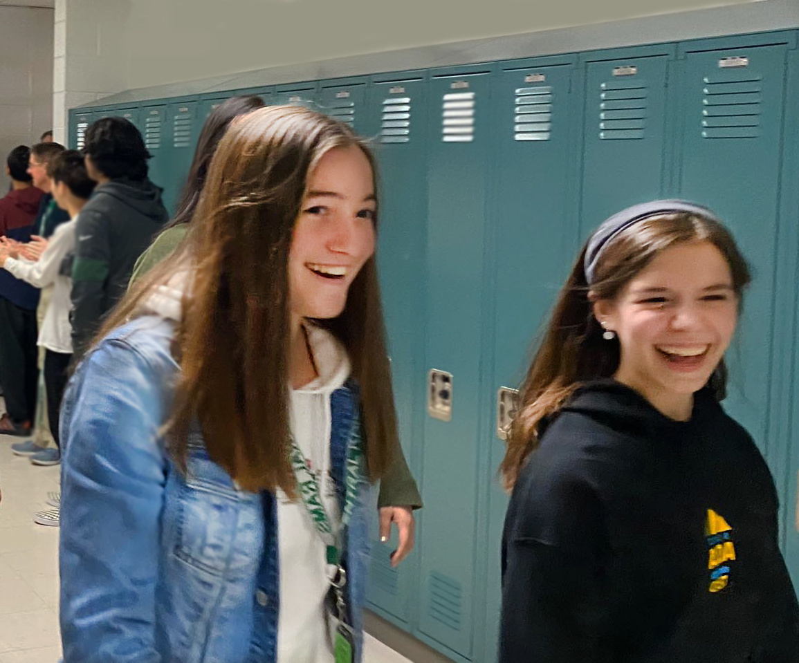 Heidloff and Whaples walk and smile during the state sendoff before Heidloff goes to ILMEA.