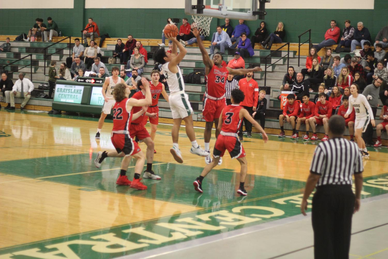 Senior Dillan Dumanlang avoids a block and shoots for two. Photo by Maia AlBarrak