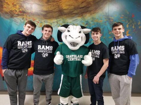 The four state wrestlers alongside school mascot Guido the Ram after their state sendoff. Photo by Nichole Trudeau.