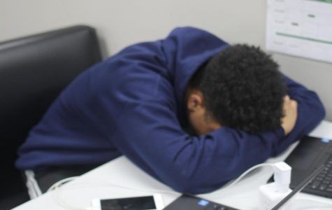 Senior Isaac Trawick, tired after a long day of school, takes a moment to relax.