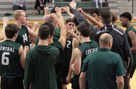 The boys' varsity volleyball team doing their pre game hype up chant, last season.