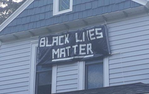 Black lives matter banner is displayed to support the movement. Photo by Daniel DeBoer.
