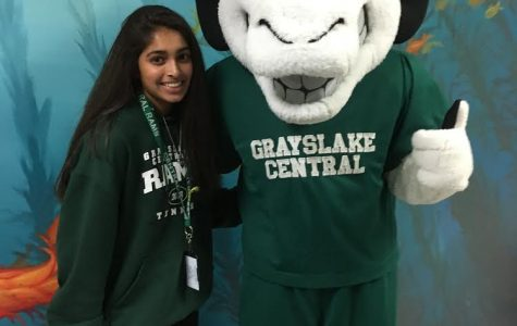 Karishma Bhalla posing for a picture with school mascot.