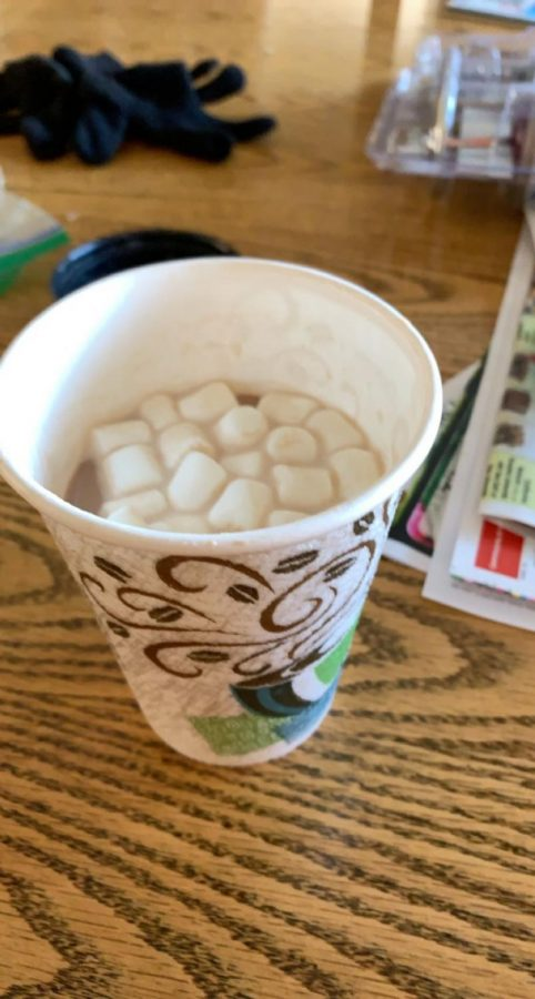 """Student council staff hand out hot chocolate to the seniors on Jan. 21. More upcoming events are being planned by staff to celebrate the seniors. Senior Jordan Groth stated, """"It made me happy that they are celebrating all of us seniors."""""""