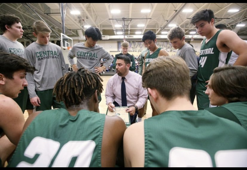 Varsity basketball coach Brian Centella bringing his team together last year in the North V. Central game. Pre-Covid sports were thriving in Grayslake; people were able to get together without worry of a virus.