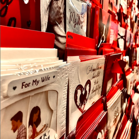 Valentine's Day cards get stocked up at Wal-Mart, ready for young lovers to buy. There are cards for spouses, mothers, fathers, siblings, and more.