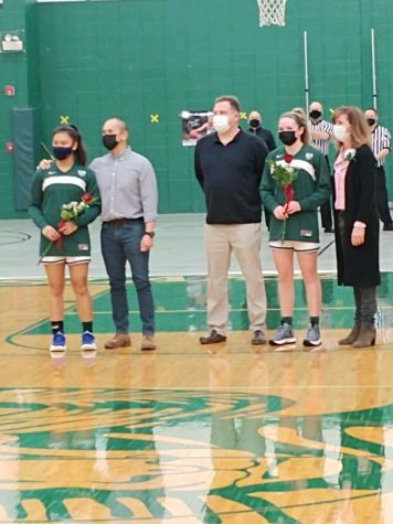Drevline and Cave pose for a picture with their parents. Both seniors were greeted with  roses gifted from Coach Ikenn. Photo provided by Mk Drevline.