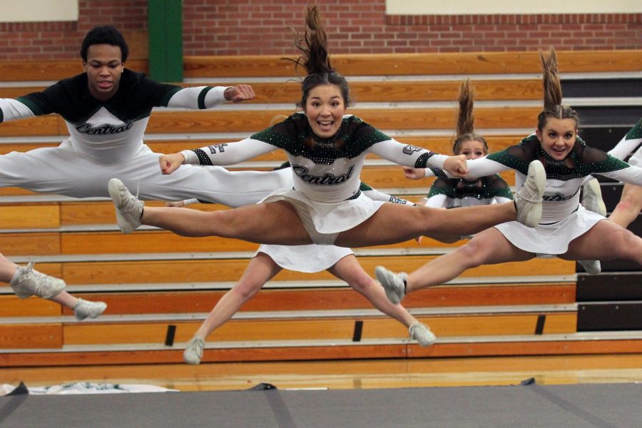 """Athletes of the GCHS cheer team perform their split jump mid-air. Although cheer may be different this year, the athletes are still grateful they get to perform. """"I think there's a lot of expectations that the kids have set for themselves but I'm just really happy that they have the opportunity to compete again this year,"""" stated Custodio."""