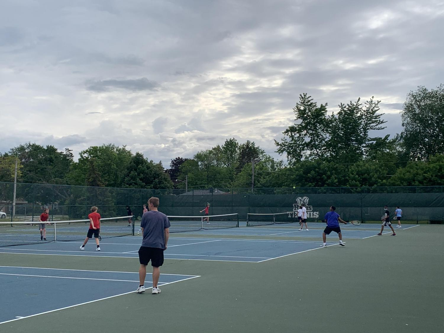 On May 25, 2021, GCHS junior varsity tennis players teamed up with varsity tennis to compete in a tournament during practice. Tennis athletes are not required to wear face masks during practice, but they still maintain social distancing.