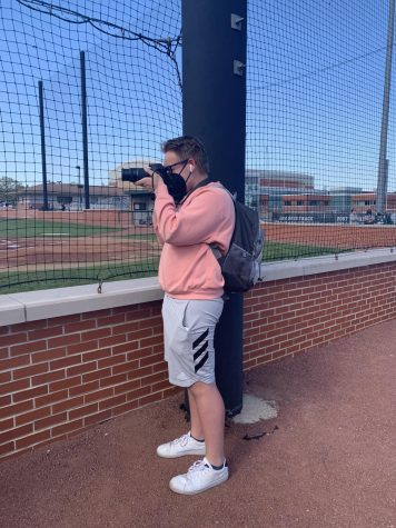 Oelschlager stays busy by taking multiple pictures of the varsity baseball team on senior day May 13. Photo provided by Janet Guckenberger.