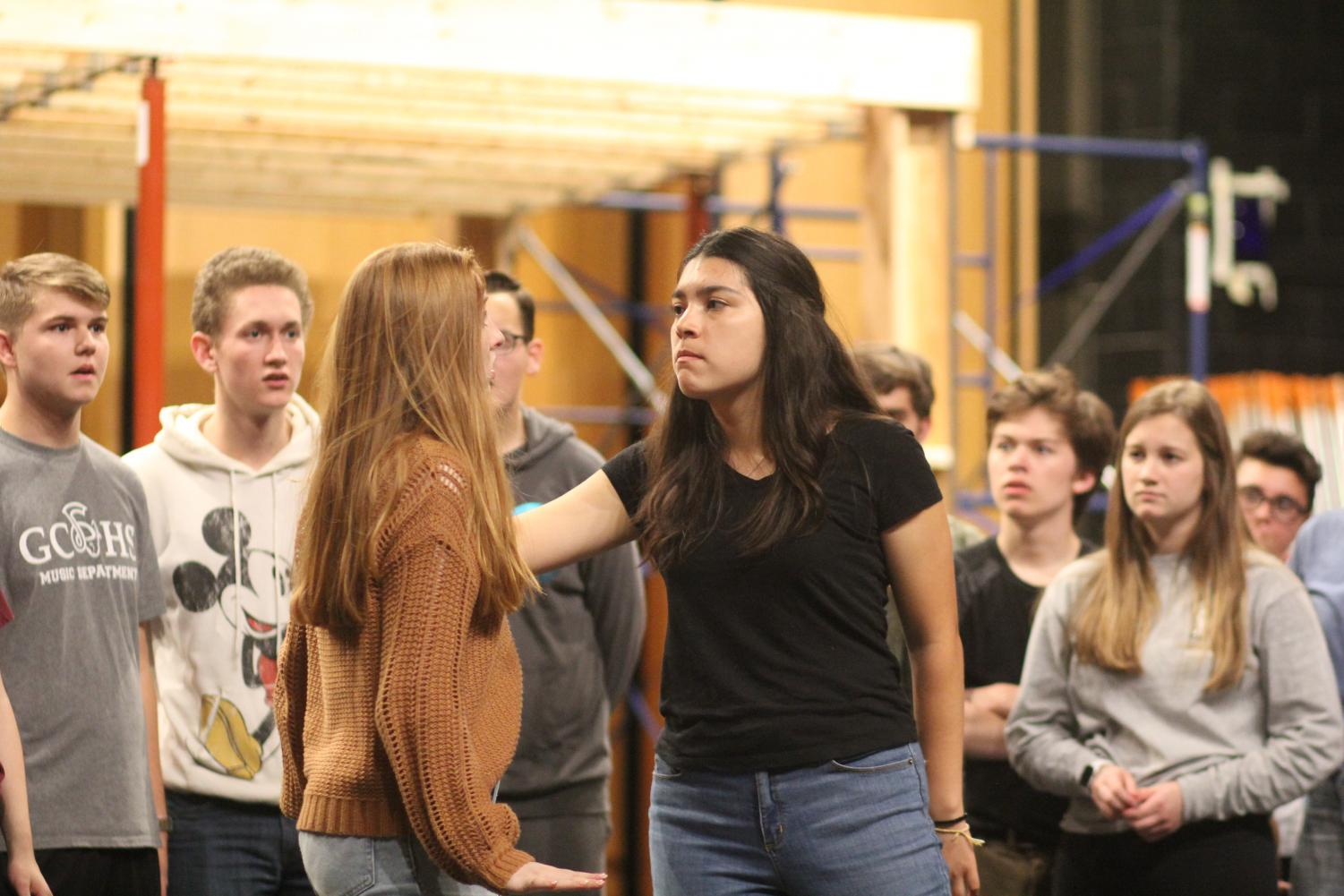 Junior Larina Pelletier gives an intense stare to sophomore Amanda Barry in a scene from 'Godspell'.