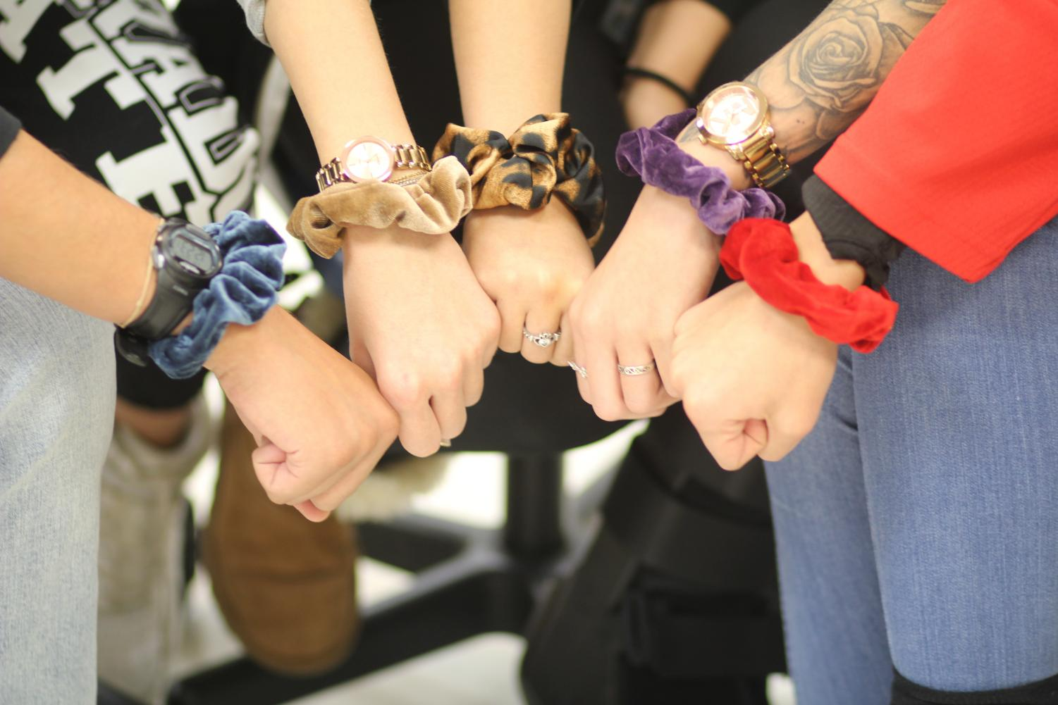 Students flaunting their scrunchies. Photo by Mykie McGill.