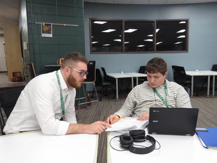 Teacher Cody Hatzer helping freshman Luciano Spaulding with math.