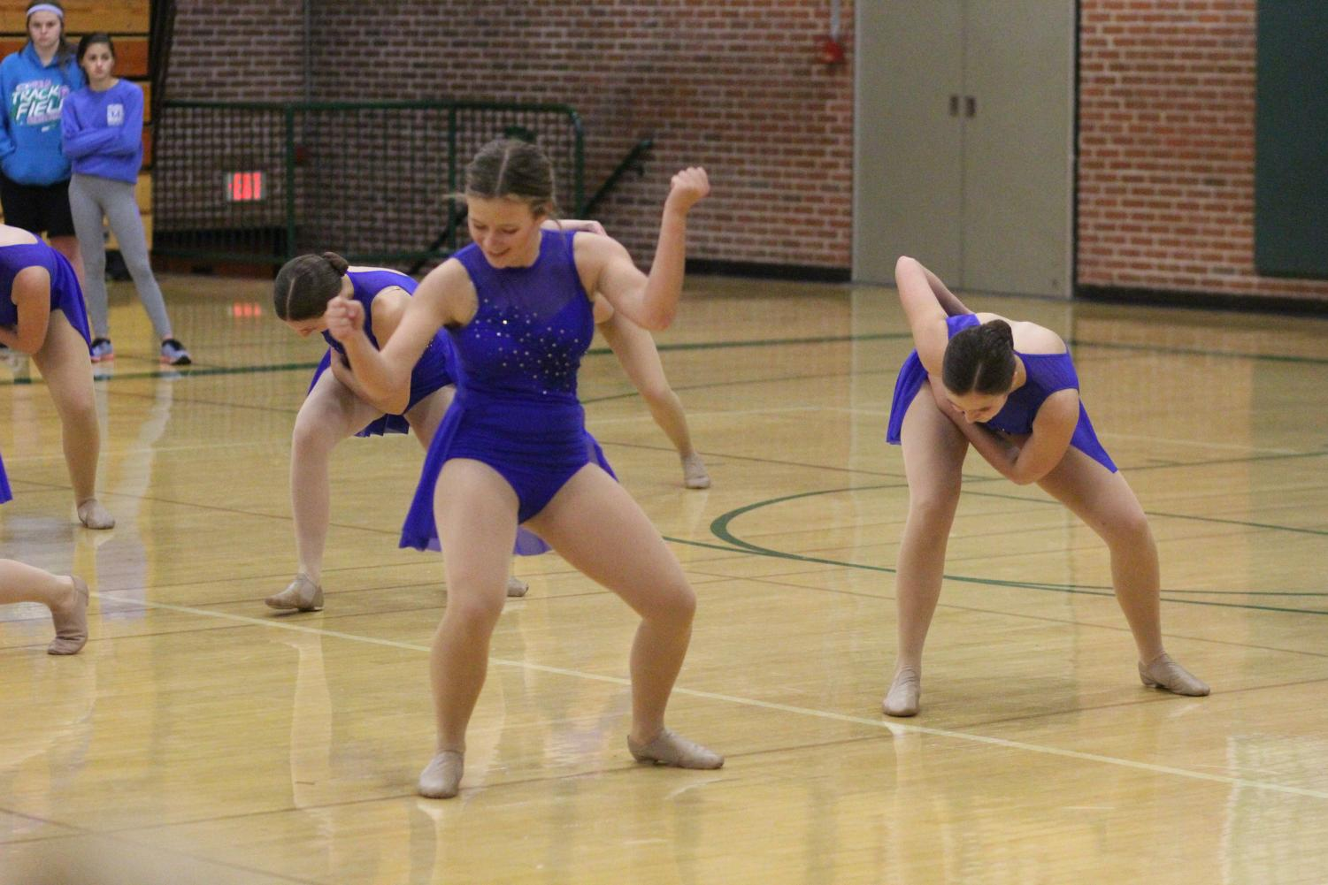 Girls' varsity team breaks out their dance routine at the Best Buddies Basketball game.