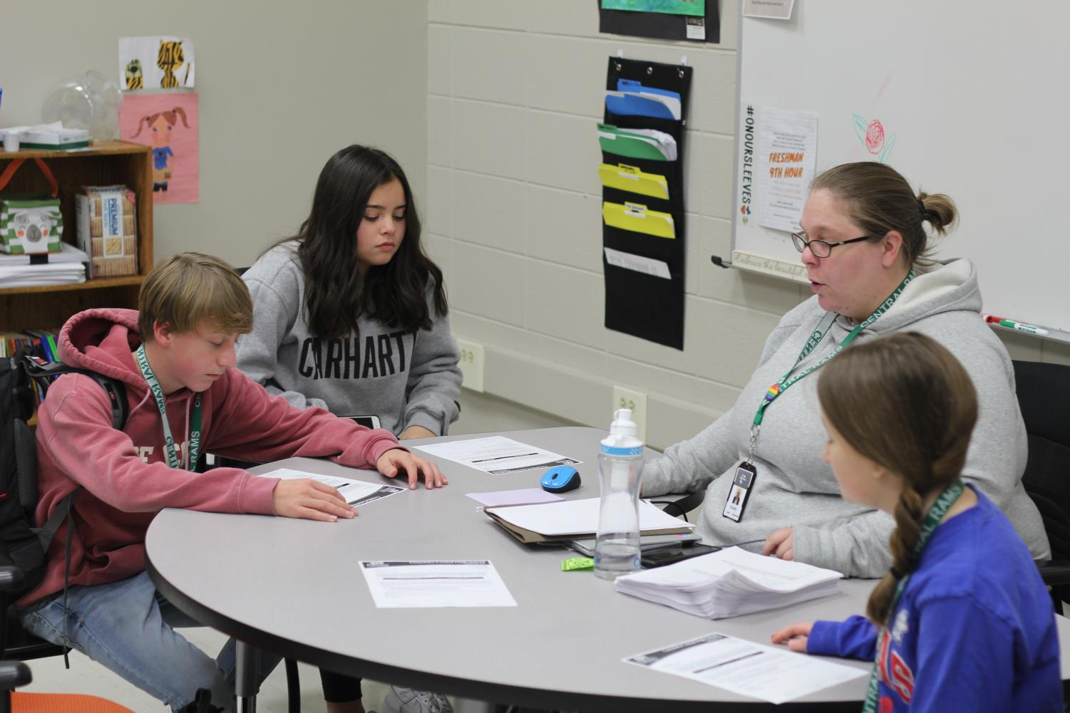 Leigh Cavanaugh helps students in their extra time through AIM. Photo by Caden Moe
