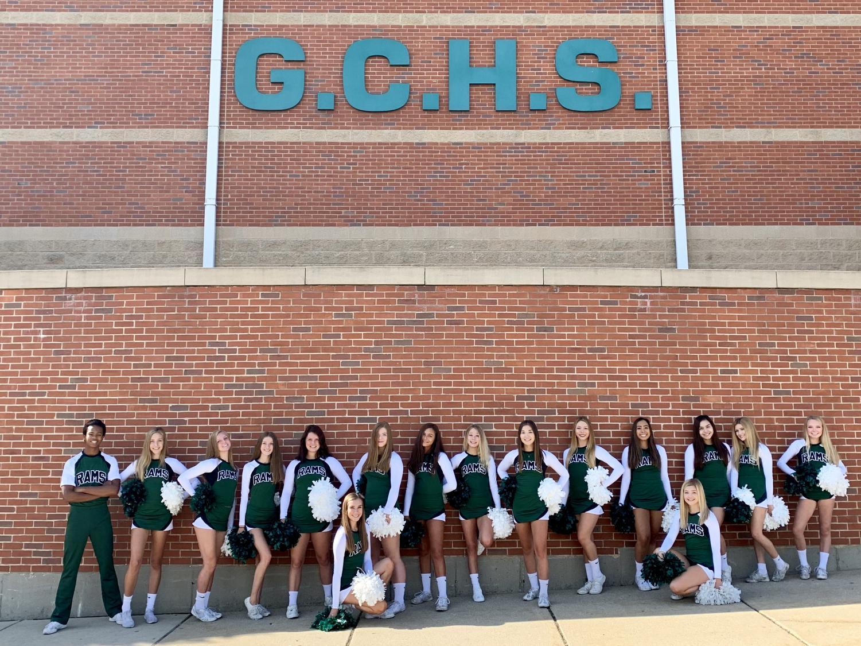 The 2019-2020 cheer team takes team photographs.