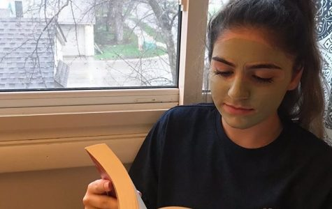 Staff reporter Maia AlBarrak enjoys her favorite book while waiting for her clay mask to dry.