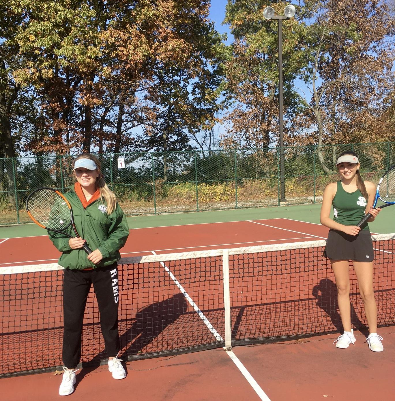 Photo of Aviva Krill (left) and Grace Caldwell (right) before clashing with Wauconda in the sectionals finals match at Lakes.
