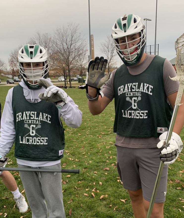 Kurt Heerdegan '22 and Marko Marynevych '22 participate in a Lacrosse contact day. To be able to play safely they are wearing their mask to try and stop the spread of COVID-19.