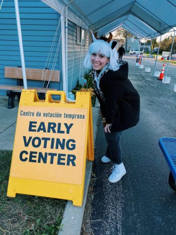 GCHS Senior Tori Whaples poses beside an early voting sign outside of a Grayslake polling location. Photo provided by Tori Whaples