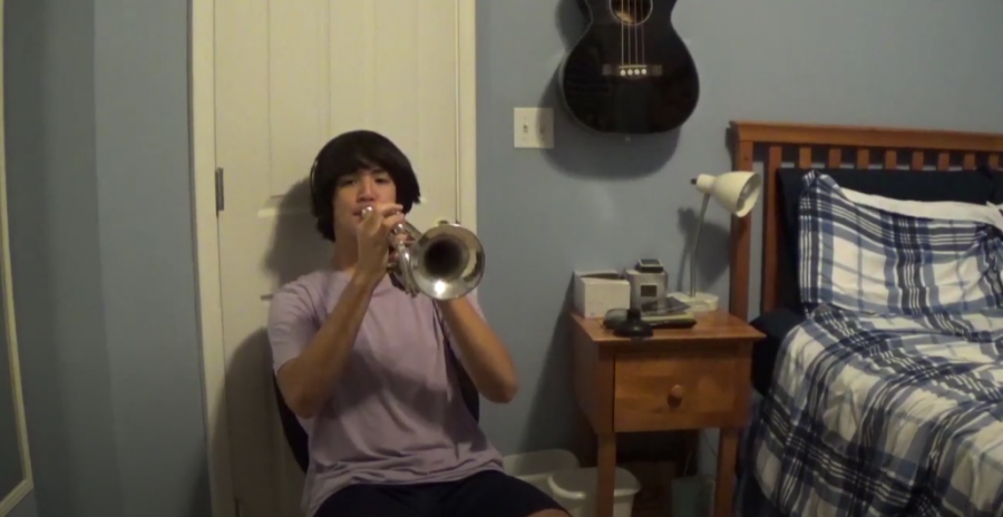 Tri-M+student+Jacob+Park+plays+his+trumpet+for+his+performance.