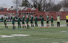 The boys soccer team stands for the national anthem, ready to take on Antioch in their pursuit to take the conference championship!