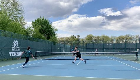 """Doubles team Nolan Blenniss and Alexander Helvie play a point on May 7 during a match against Antioch. GCHS varsity tennis won 7-0 against Antioch. According to Helvie, """"Tennis has affected my life in a positive way. There"""