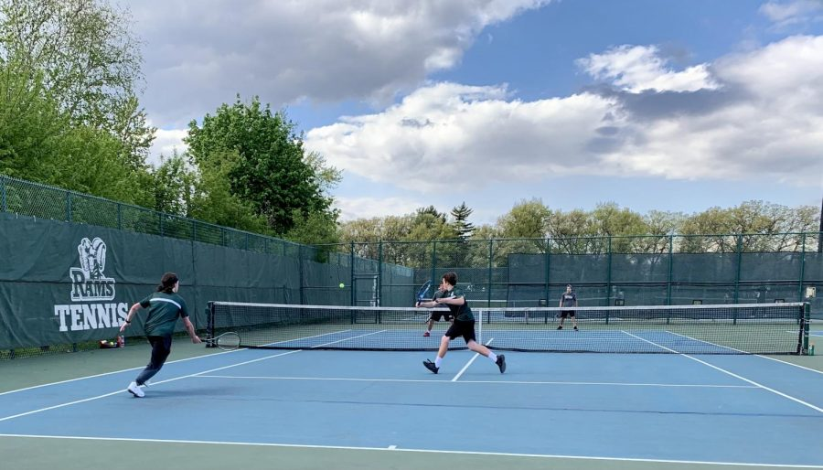 """Doubles team Nolan Blenniss and Alexander Helvie play a point on May 7 during a match against Antioch. GCHS varsity tennis won 7-0 against Antioch. According to Helvie, """"Tennis has affected my life in a positive way. There's just a lot of things it has done. It has brought me new friends and new opportunities."""""""