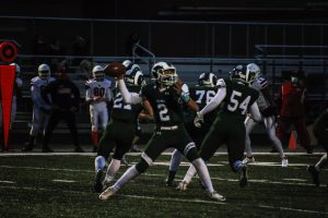 """Varsity quarterback Daryl Overstreet prepares to throw a pass against North Chicago in their last home game. The team ended the season with a winning record of 3-2, which hasn't been done at Central for almost ten years. """"I think weve created a fabric of belief of hard work,"""" said Maloney."""
