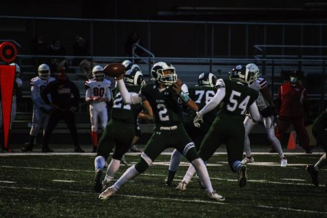 """Varsity quarterback Daryl Overstreet prepares to throw a pass against North Chicago in their last home game. The team ended the season with a winning record of 3-2, which hasn't been done at Central for almost ten years. """"I think we"""