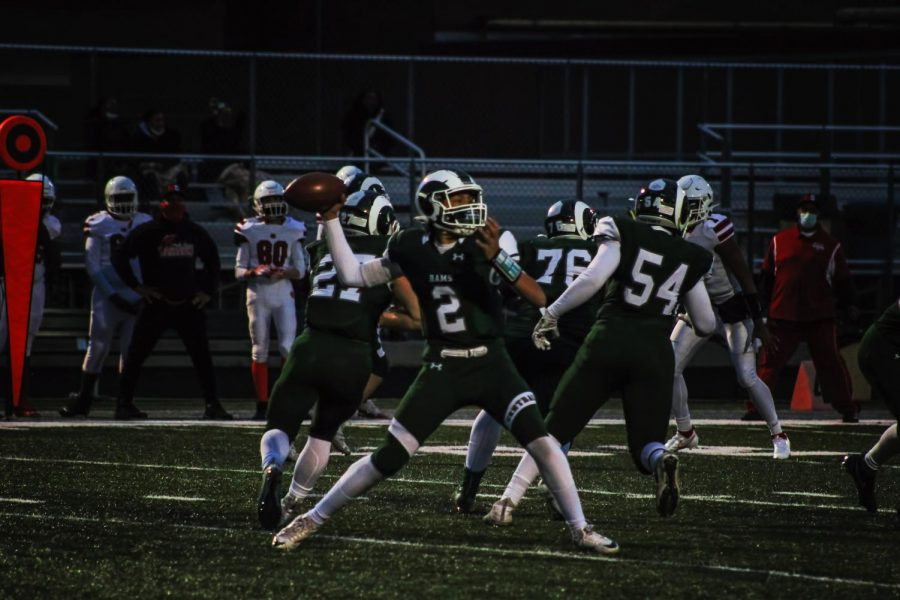 """Varsity quarterback Daryl Overstreet prepares to throw a pass against North Chicago in their last home game. The team ended the season with a winning record of 3-2, which hasn't been done at Central for almost ten years. """"I think we've created a fabric of belief of hard work,"""" said Maloney."""