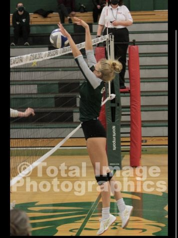 """Piper Gallaher blocks the ball from hitting the ground to help secure a win for her team. Even with the positives the girls volleyball faced this year, Gallaher explains, """"This team is a great team, but we will be back next year even better."""""""
