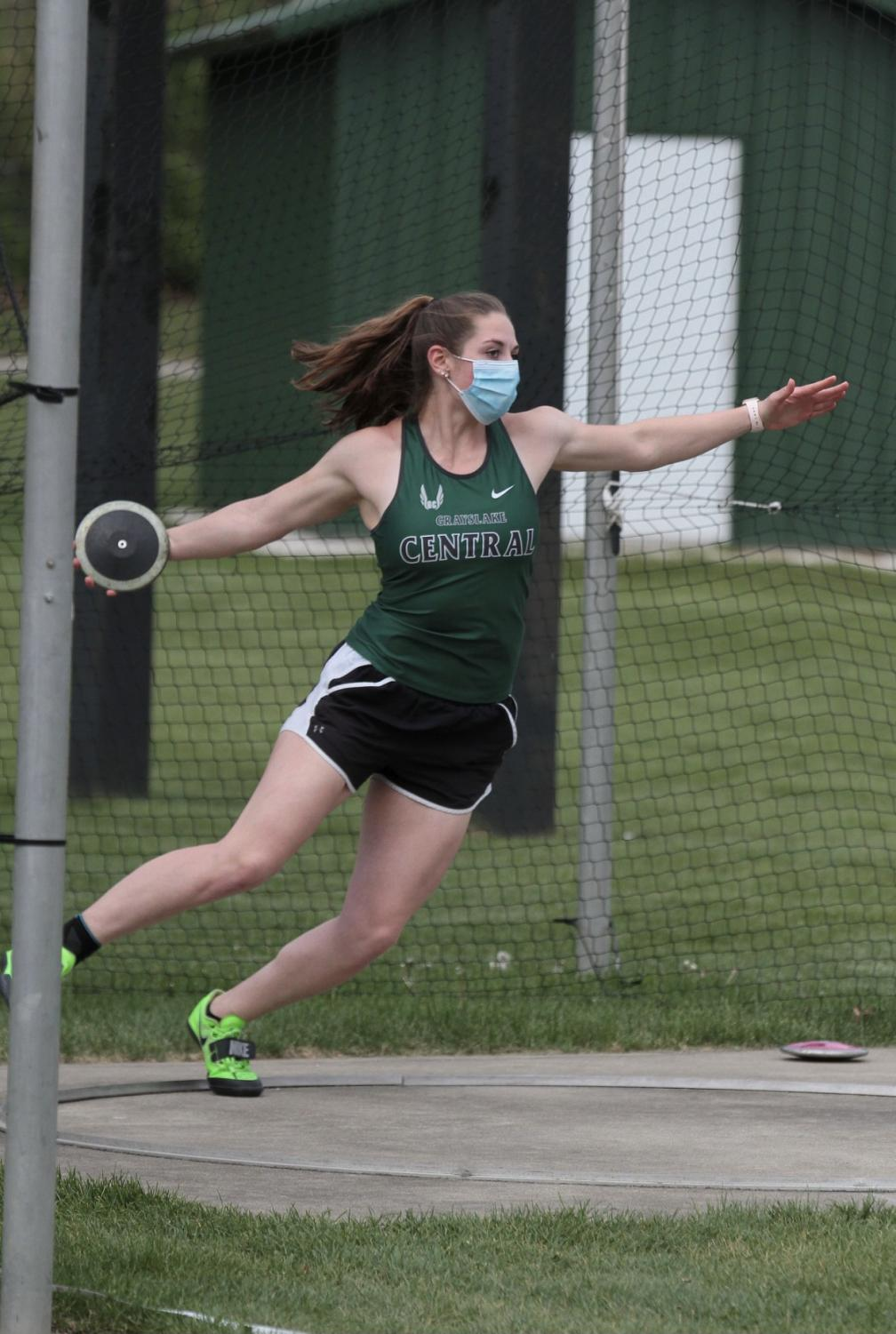 Julia Reglewski performing a discus throw. She set a new record with a throw of 138 feet and 2 inches.
