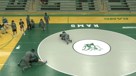 """With the seasonal sports being held via LiveStream, varsity wrestling warms up before clashing against the McHenry High School Warriors and the Waukegan High School Bulldogs on May 4. Dennis Carcamo shared the mentality he always applies during his matches. """"I just have to push through the pain and mentally prepare myself to win because it's going to be a fight throughout all of those six minutes,"""" said Carcamo."""