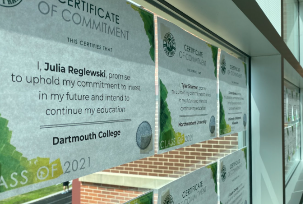 In the field house hallway, certificates of commitment are listed for seniors. The class of 2021 has been hard at work these past few months applying and getting ready to make a decision on their college of choice.